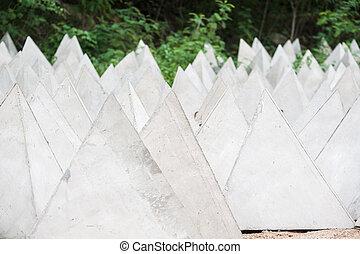 Cement block triangular pyramid, buoy.
