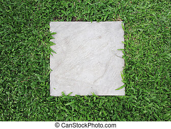 cement block with green grass background