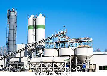 Cement factory machinery on a clear blue day