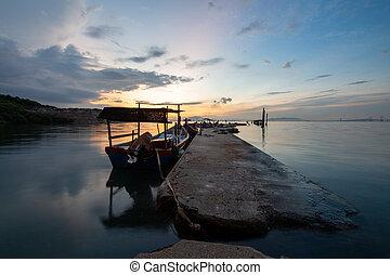 Cement fisherman jetty Jelutong, Penang, Malaysia during sunrise.
