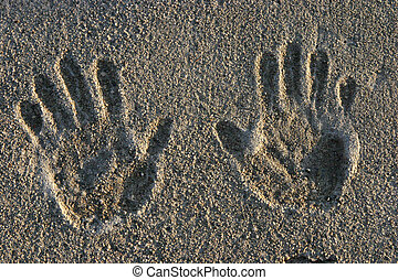 Cement Hand Prints - Hand prints on a cement sidewalk.