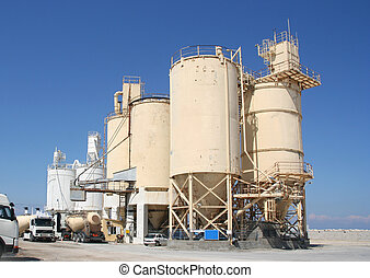 Cement Industry - Cement industry with silos and trucks