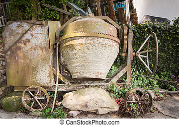 Cement mixer - Aged cement mixer machine left in garden