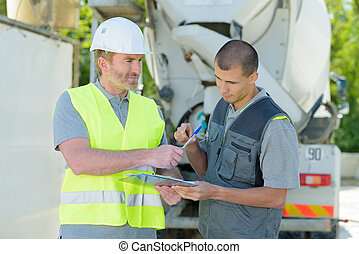 cement mixer transportation driver asking for signature