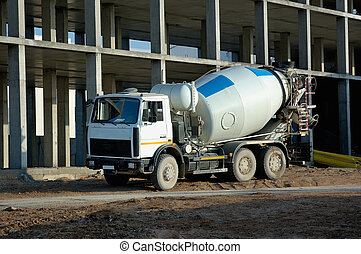 cement mixer truck - car mixer against a building under ...