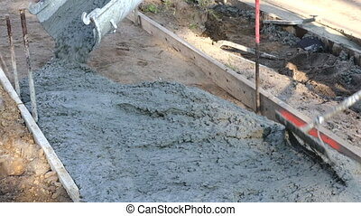Cement of sidewalk a new building under construction - ...