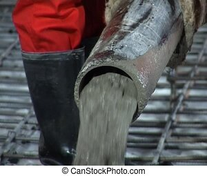 cement pouring - the close-up of the pouring of wet cement...