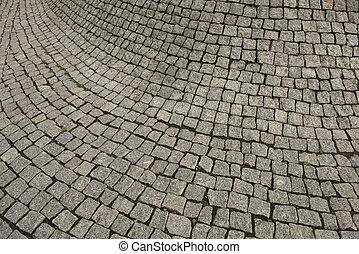Cement tile curving outward into a bulge