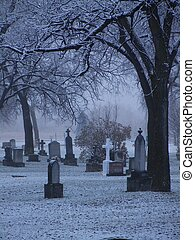 Cemetary in the snow - Oold headstones with a light dusting ...