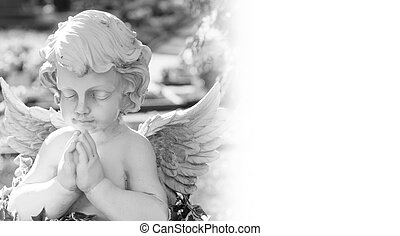 Angel on a cemetery in black and white