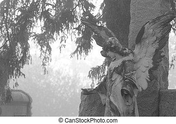 Cemetery Angel statue in fog