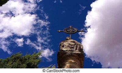 Cemetery column with cross timelaps