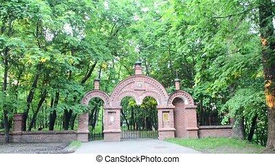 Cemetery gate - Old Cemetery gate near church in a park