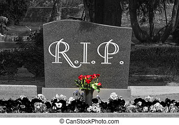 Grave stone with the word RIP in black and white