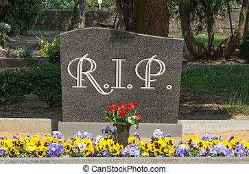 Grave stone with the word RIP