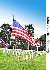 Cemetery Memorial - American flags on tombstones in cemetery...