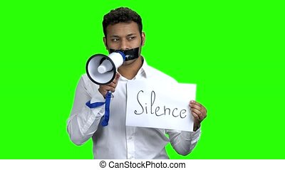 Censored man with black tape over mouth. Silenced man with...