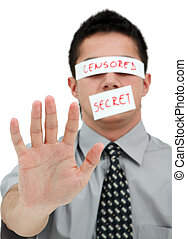 Young businessman with band on his eyes and mouth showing his hand to us