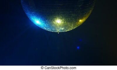 Center look of Disco mirror ball in smoke . close up