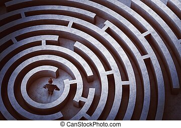 Center of a maze - Businessman at the center of a maze