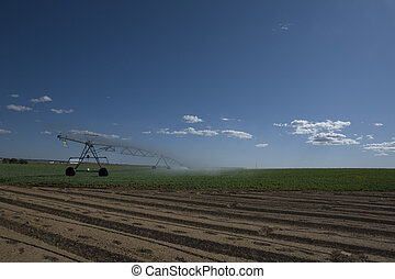 Center pivot irrigation furrows