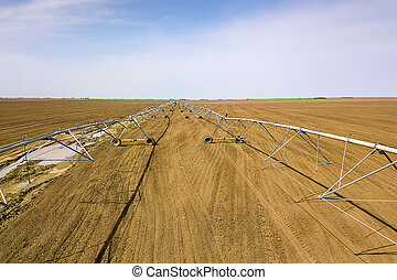 Center pivot irrigation system. Agricultural land, Aerial View.