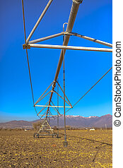 Center pivot irrigation system in empty field fall