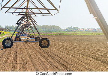 Center Pivot Irrigation System in field. Agriculture.