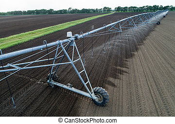 Center pivot irrigation system on field