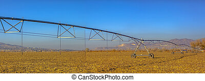 Center pivot irrigation system panorama in field