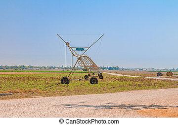 Center pivot sprinkler system in an agricultural field