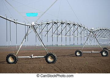 center pivot sprinkler system on field agriculture