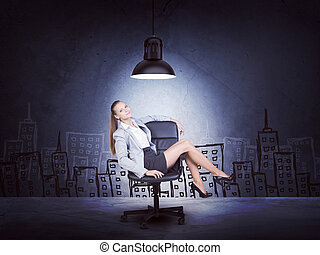 Centered woman wearing jacket, blouse sitting with legs crossed. Background sketch of buildings