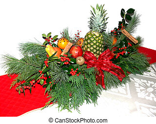 A beautiful centerpiece on a red table runner and white table cloth and background.
