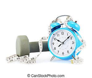 Centimeter tape, clock and dumbbell