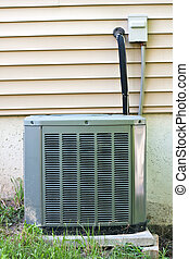 Central AC Condenser Unit - A residential central air...