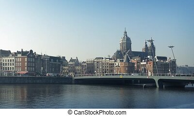 Central Amsterdam With Boat Passing - Bridge through the...