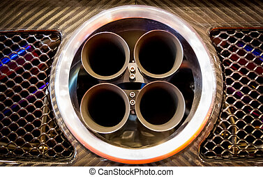 exhaust pipes of a sports car