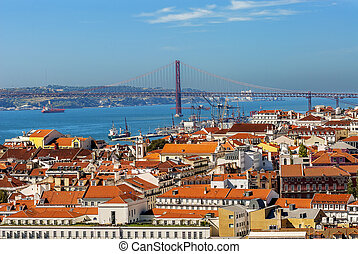 Bird view of central Lisbon with colorful houses and orange roofs