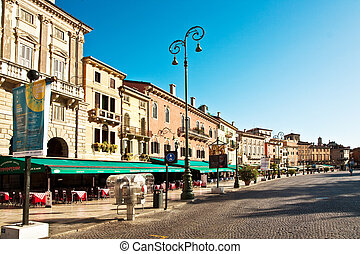 market place with restaurants in front of the famous Arena from Verona