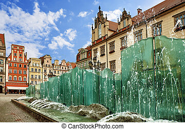 Central market square in Wroclaw Poland with old colorful houses and famouse fountain on a bright summer day. Travel vacation concept