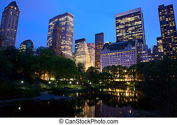 Central Park and New York City skyline at dusk, USA
