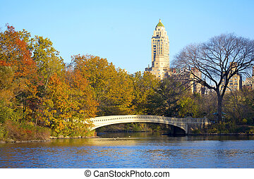 Central Park in NYC - Bow Bridge at Central Park with ...
