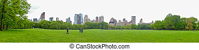NEW YORK - JULY 1: People enjoying relaxing outdoors in Central Park on July 1, 2014 in New York. The park is the most visited urban park in the United States with 35 million visitors annually.