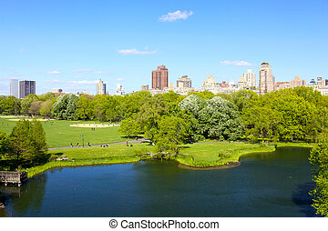 Central Park with Manhattan skyscrapers over Turtle Pond, ...