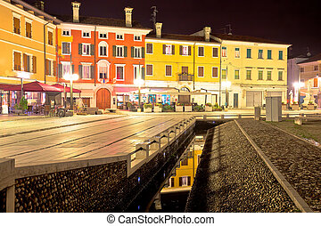 Central square colorful architecture in Italian town of...