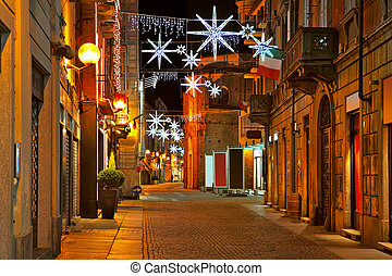 Central street at evening. Alba, Italy. - Old city central ...