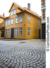 Central street of Bergen, Norway - Old yellow building in...