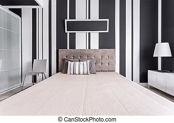 Central view of bed in fancy bedroom