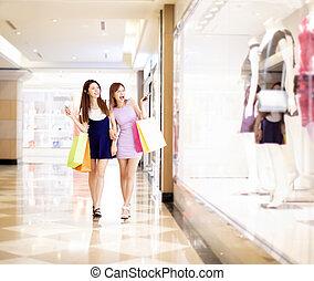centro commerciale, shopping donna, giovane, felice